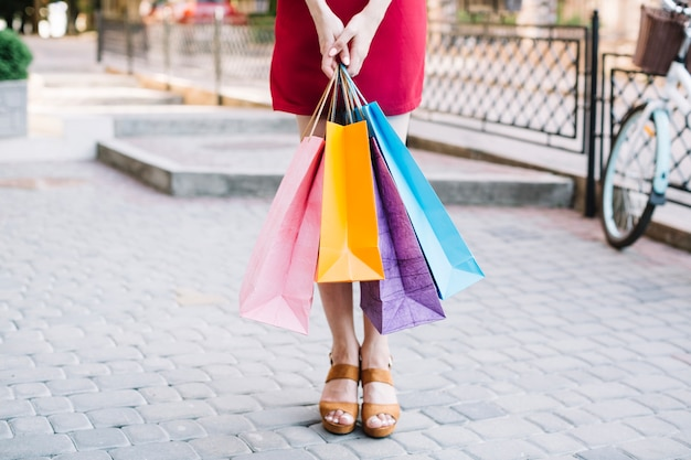 Standing woman with paper bags
