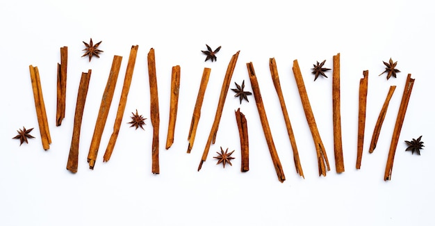 Star anis and cinnamon sticks on white.