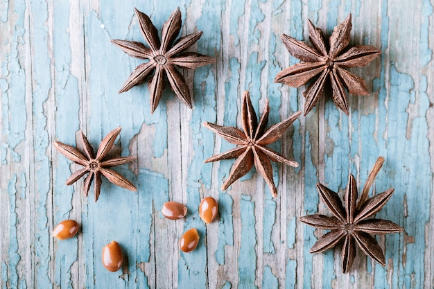 Star anise on blue old wood