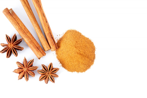 Star anise, cinnamon sticks and powder isolated