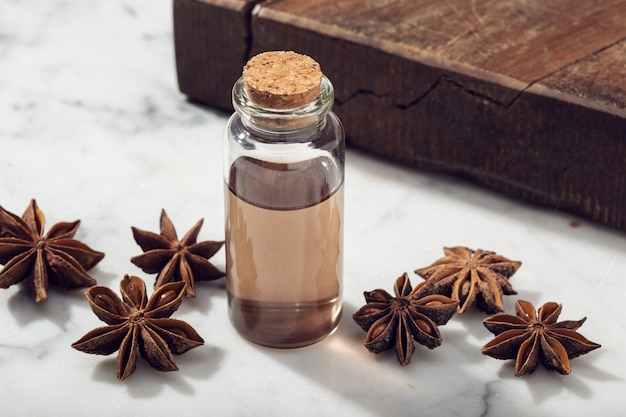 Star anise essential oil on marble table
