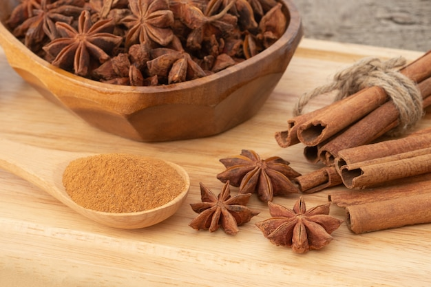 Star anise isolated on wooden table background.