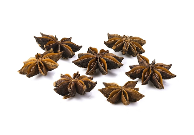 Star anise spice fruits and seeds isolated on white closeup
