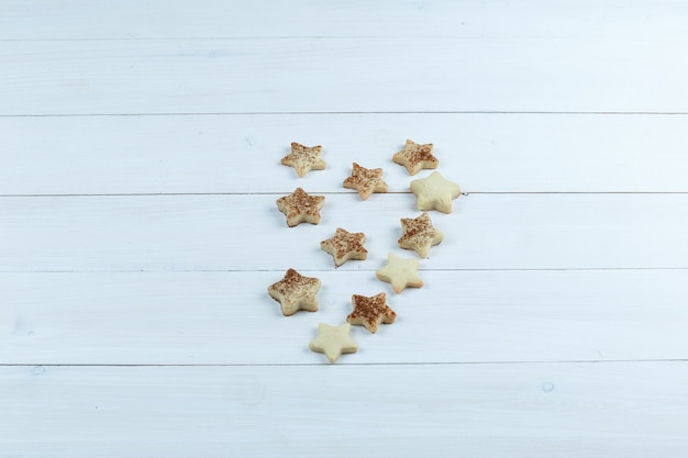 Star cookies on a white wooden board background. high angle view.