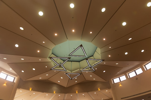 Star of david's stylized chandelier is made of six triangles: magen david lamp