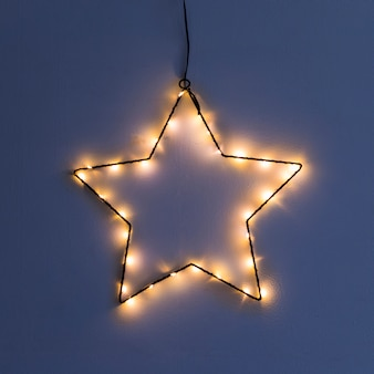 Star made from garland on wall