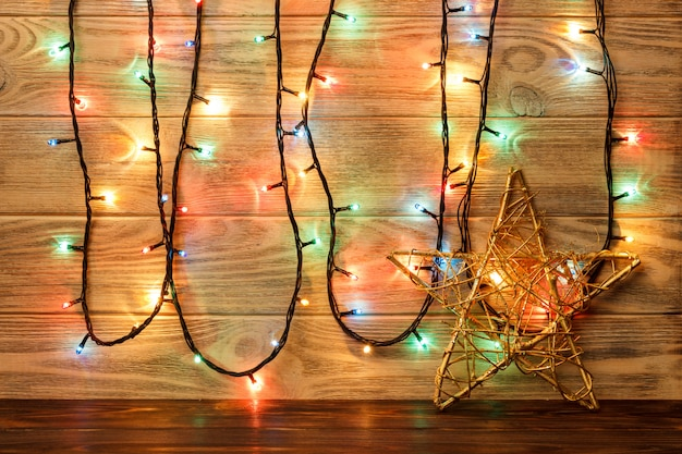 Star object is on the floor against the backdrop of a wooden wall. big star