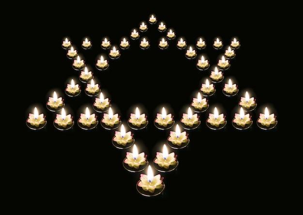 검정색 배경에 있는 giridih 양초에서 다윗의 별. 독일 제3제국의 유태인 학살 추모의 개념