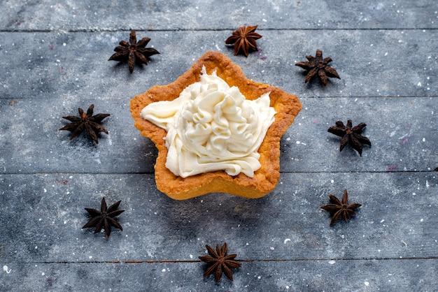 Star shaped cake with cream on light desk, cake biscuit sweet sugar bake cream