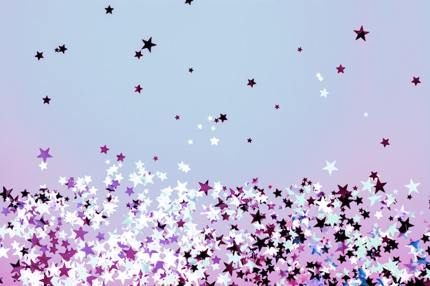 Star shaped confetti blue and purple background