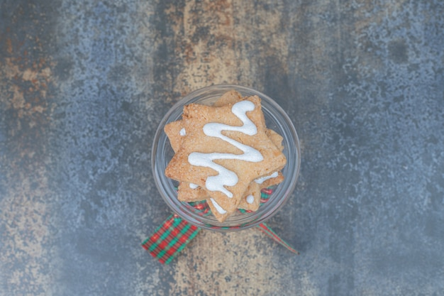 Star shaped gingerbread cookies on glass decorated with ribbon. high quality photo