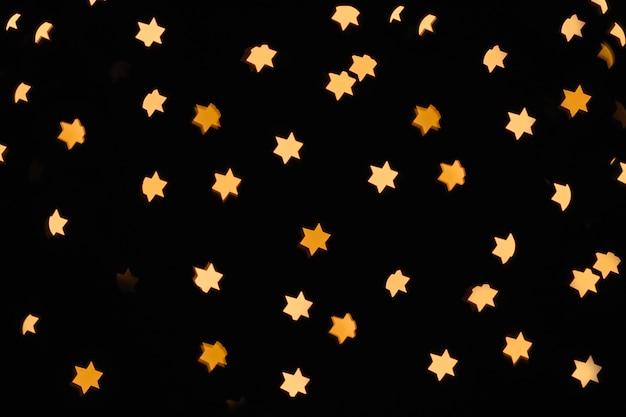 Star-shaped lights on black