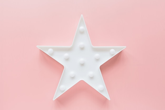 Star shaped white led lamp on pink