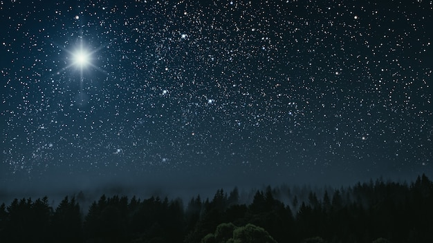Star shines over the manger of christmas of jesus christ.