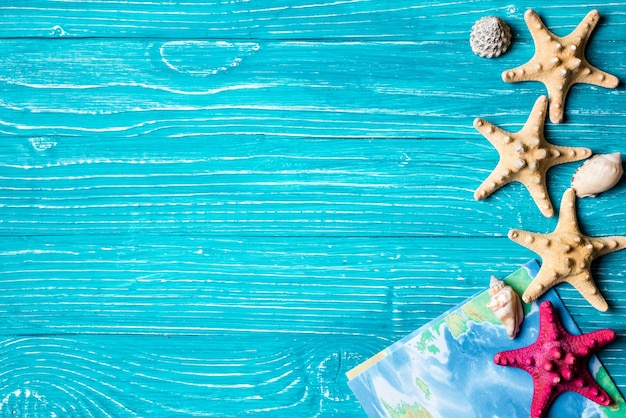 Starfish and nap located on blue wooden background