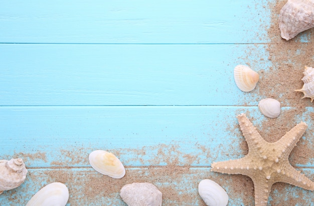 Starfish and seashells with sand on wooden. summer concept