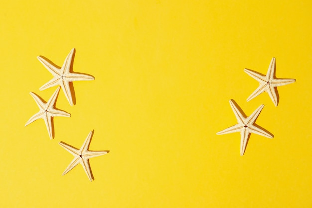 Starfishes on yellow, space for text