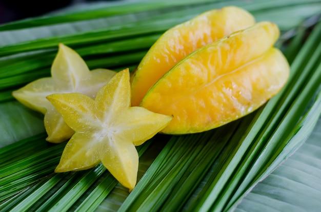 Starfruit, carambola on green leaf