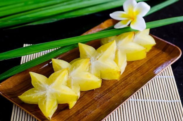 Starfruit, carambola on wooden plate