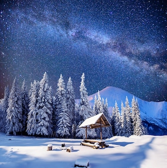 Starry sky in a fantastic mountain village