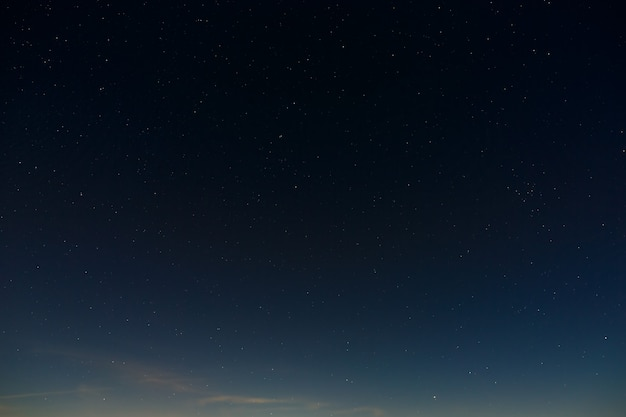 Stars in the night sky. outer space background with the full moon photographed.