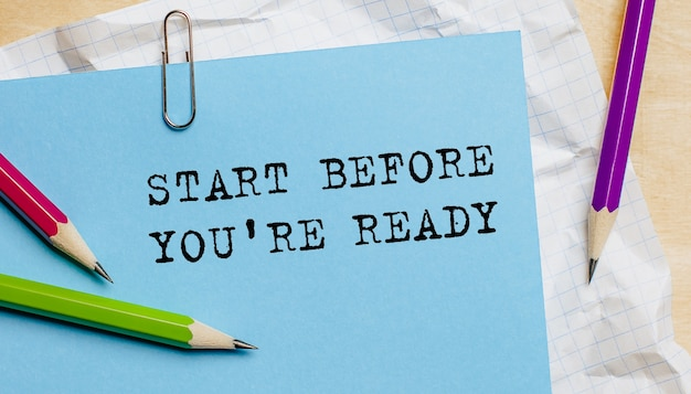 Start before you're ready text written on a paper with pencils in office