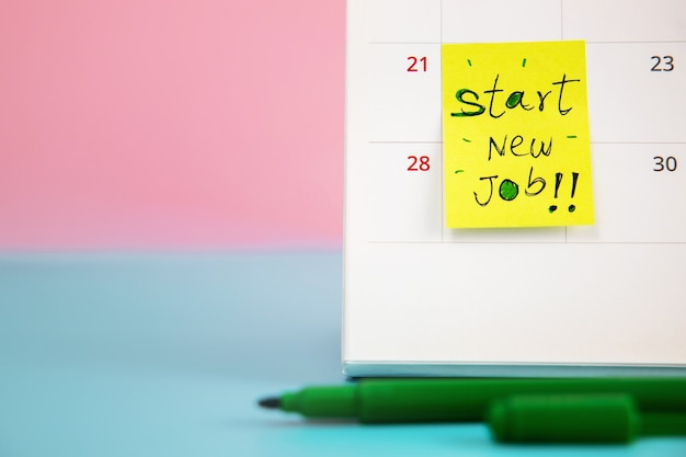 Start a new career concept. close-up of calendar with start new job wording, challenging of occupation for new employee