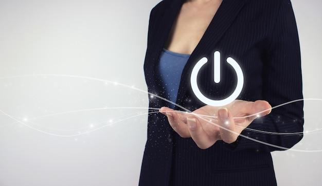 Start or shut down concept. hand hold digital hologram power button icon