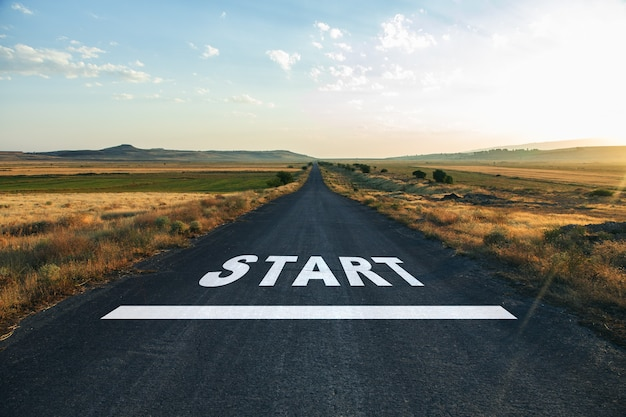 Start text on road at the sunset