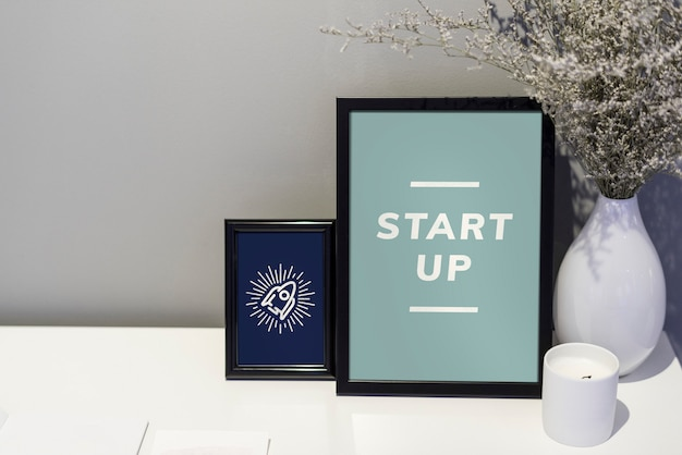 Start up quote and illustration in picture frames