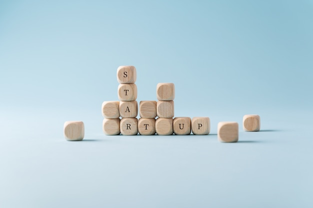 Start up sign spelled on wooden dices