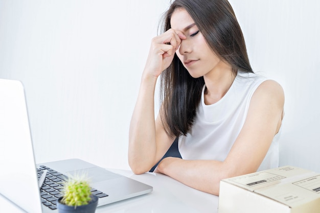 Start up small business entrepreneur sme or freelance woman working hard and feeling dizzy at home
