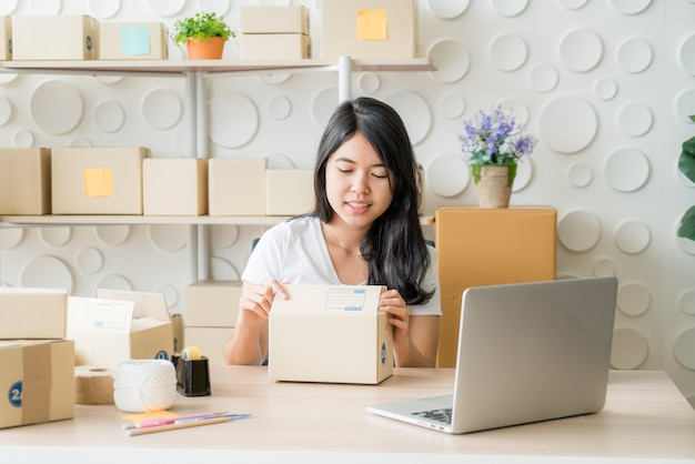 Start up small business entrepreneur sme or freelance woman working at home