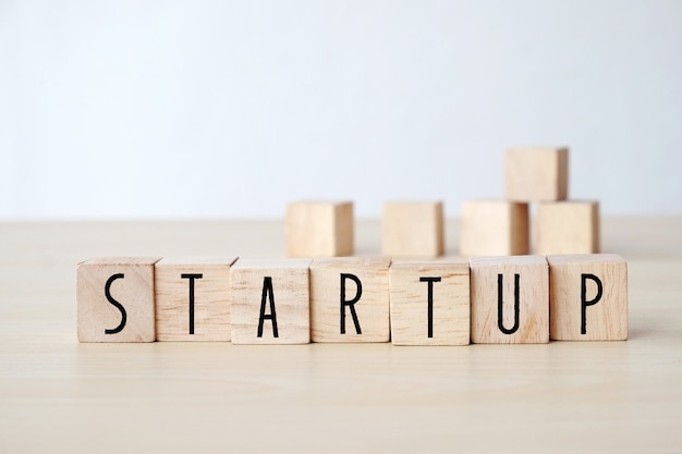 Start up word on wooden cubes background