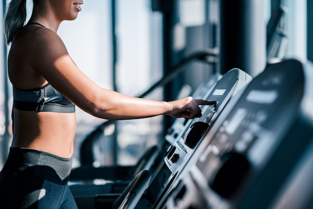 Starting cardio workout on a treadmill.