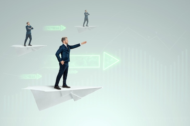 Startup. businessman flying on a paper airplane and arrows forward