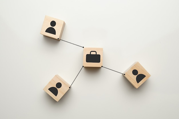 Startup concept - abstract signs of a case and people on wooden cubes with a white space.