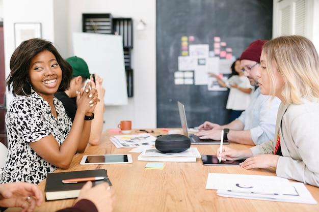 Startup team brainstorming in meeting room using blackboard