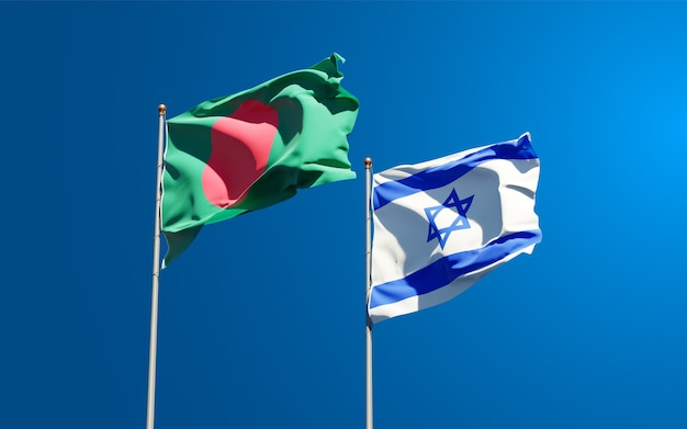 State flags of israel and bangladesh together on sky background