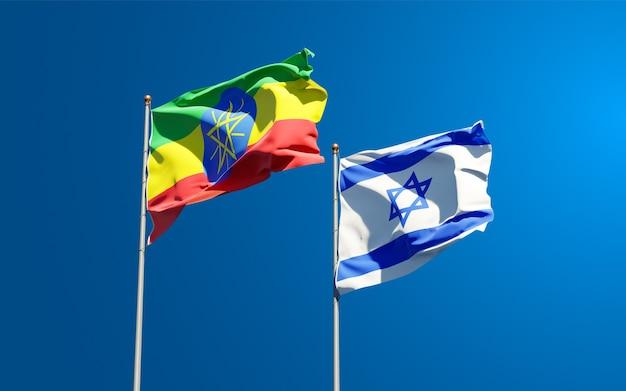 空の背景に一緒にエチオピアとイスラエルの州旗