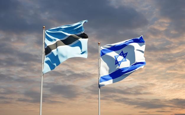 空の背景で一緒にイスラエルとボツワナの州旗