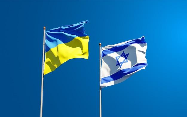Государственные флаги украины и израиля вместе на фоне неба