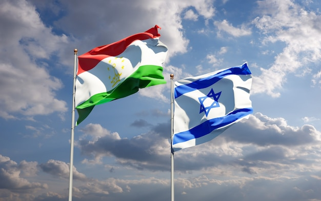 State flags of tajikistan and israel together on sky background