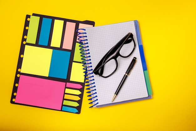 Stationary concept. pen, glasses sticky note. office supplies.