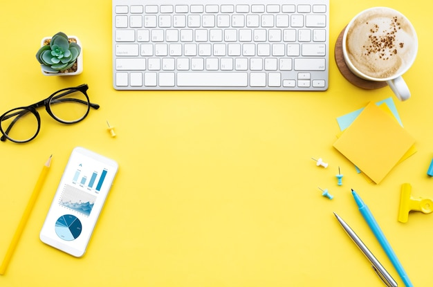 Stationary on the desk on yellow background