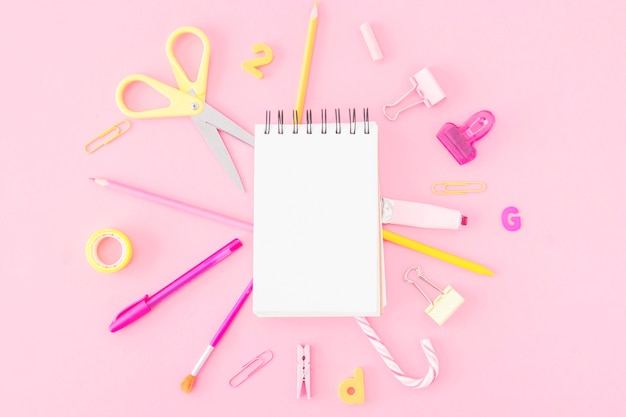 Stationery around blank notebook