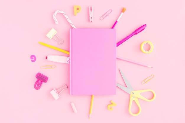 Stationery around notepad