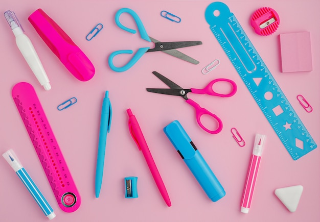 Stationery background on pink. school supplies, studying concept