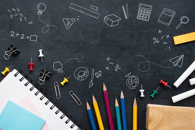 Stationery on blackboard background