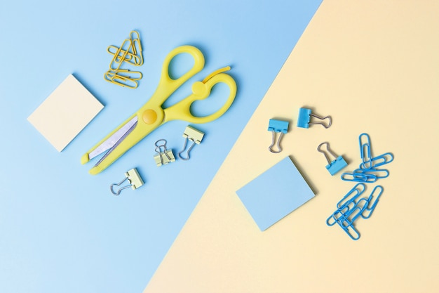 Stationery on blue and yellow background. back to school concept.